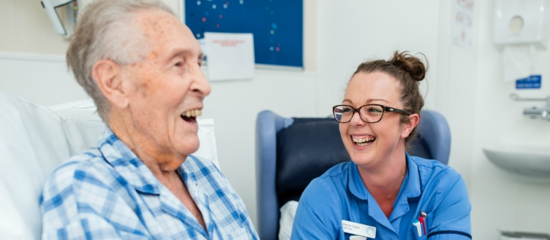 Patient and nurse laughing
