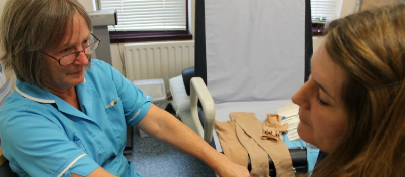 Lymphoedema clinic patient and nurse