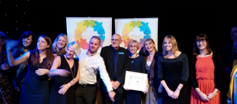 staff celebrate charity of the year win
