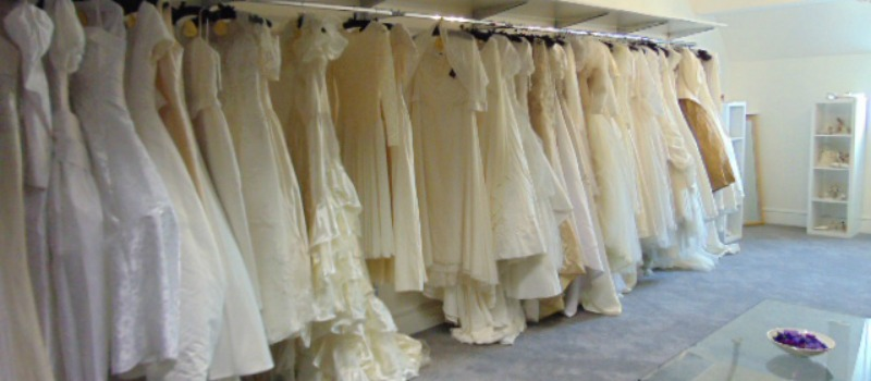 bridal dresses hanging in Bishopric shop
