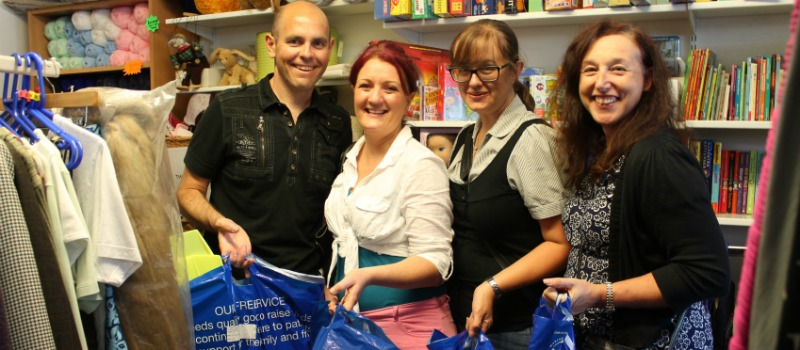 Gatwick staff with donation bags in St Catherine's Hospice charity shop