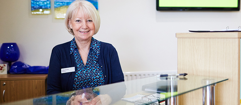 St Catherine's Hospice receptionist ready to welcome new visitors