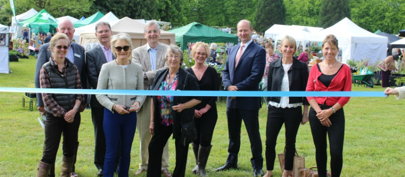 Garden and produce fair being opened with a ribbon