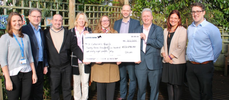 Unum cheque presentation in hospice garden