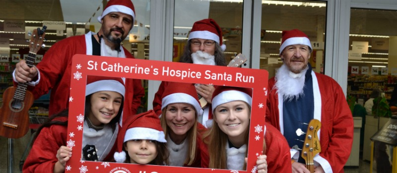 Santa Run launch in Caterham, people with a seflie frame