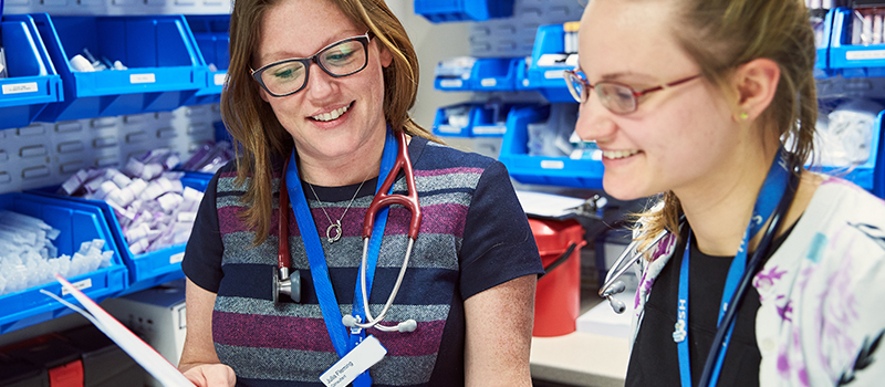 St Catherine's Hospice placements - doctors discuss a patient chart