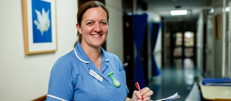 refer patients to nurse holding a clipboard