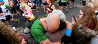 St Catherine's Hospice London Marathon runner hugs his wife mid-race